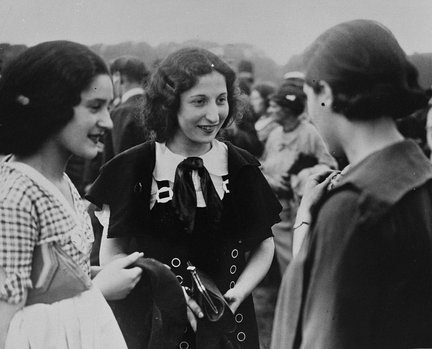 Three young Jewish women converse at a mass demonstration in Hyde Park to protest against the Nazi persecution of German Jewry.