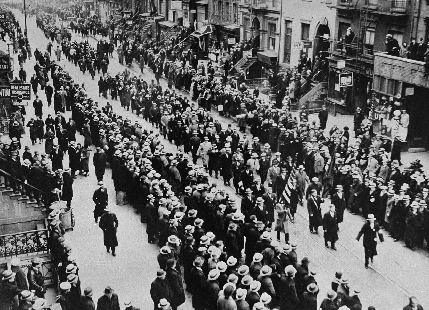 Jewish war veterans march to city hall with members of the American Legion and other veterans organizations to protest against the Nazi persecution of German Jews.  At city hall they will present a petition to the mayor, asking Congress to lodge a formal protest against the Nazi regime.