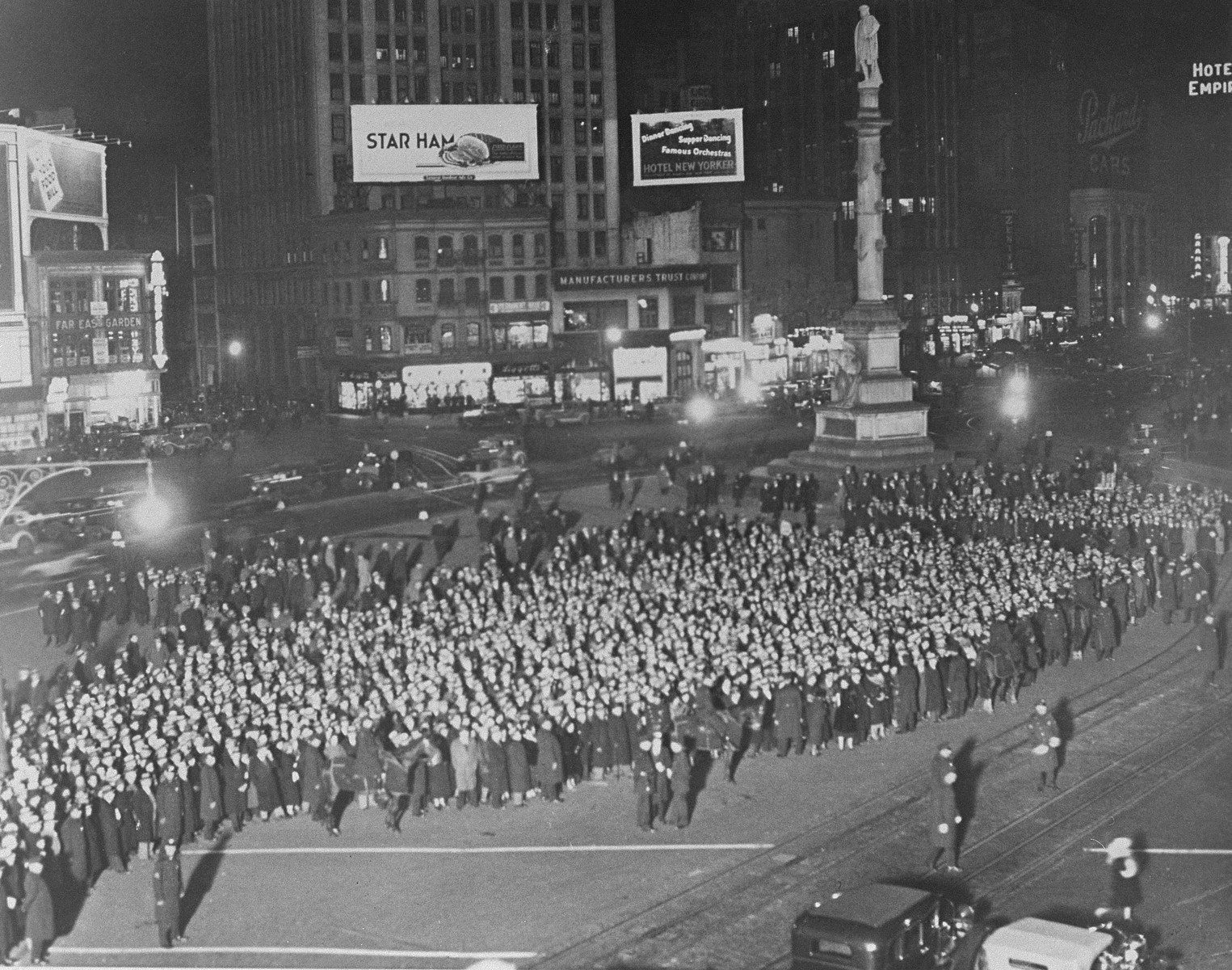 Thousands parade through Columbus Circle in Manhattan in a march to protest against the Nazi persecution of European Jews.