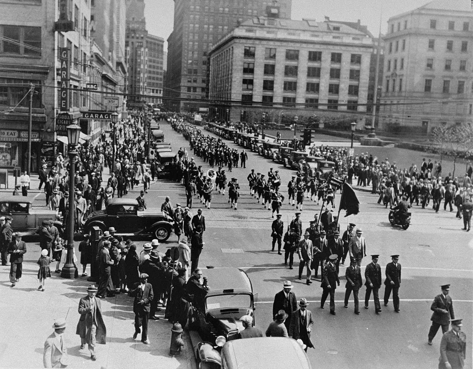 Marchers parade through the streets of Cleveland to protest against the Nazi persecution of German Jews.  The march was followed by a mass meeting at Public Hall in which 10,000 people took part.