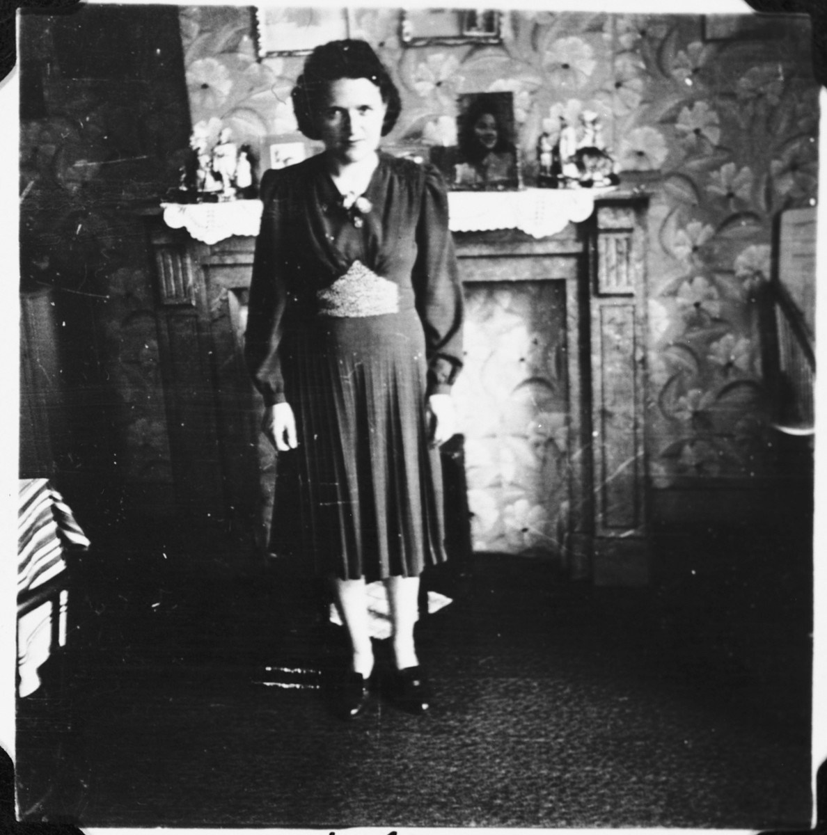 A Jewish woman who is living in hiding as a Christian, poses in the living room of her sister's apartment in Brussels, where her children were sheltered for many months during the German occupation.  Pictured is Fani Mendelowicz.