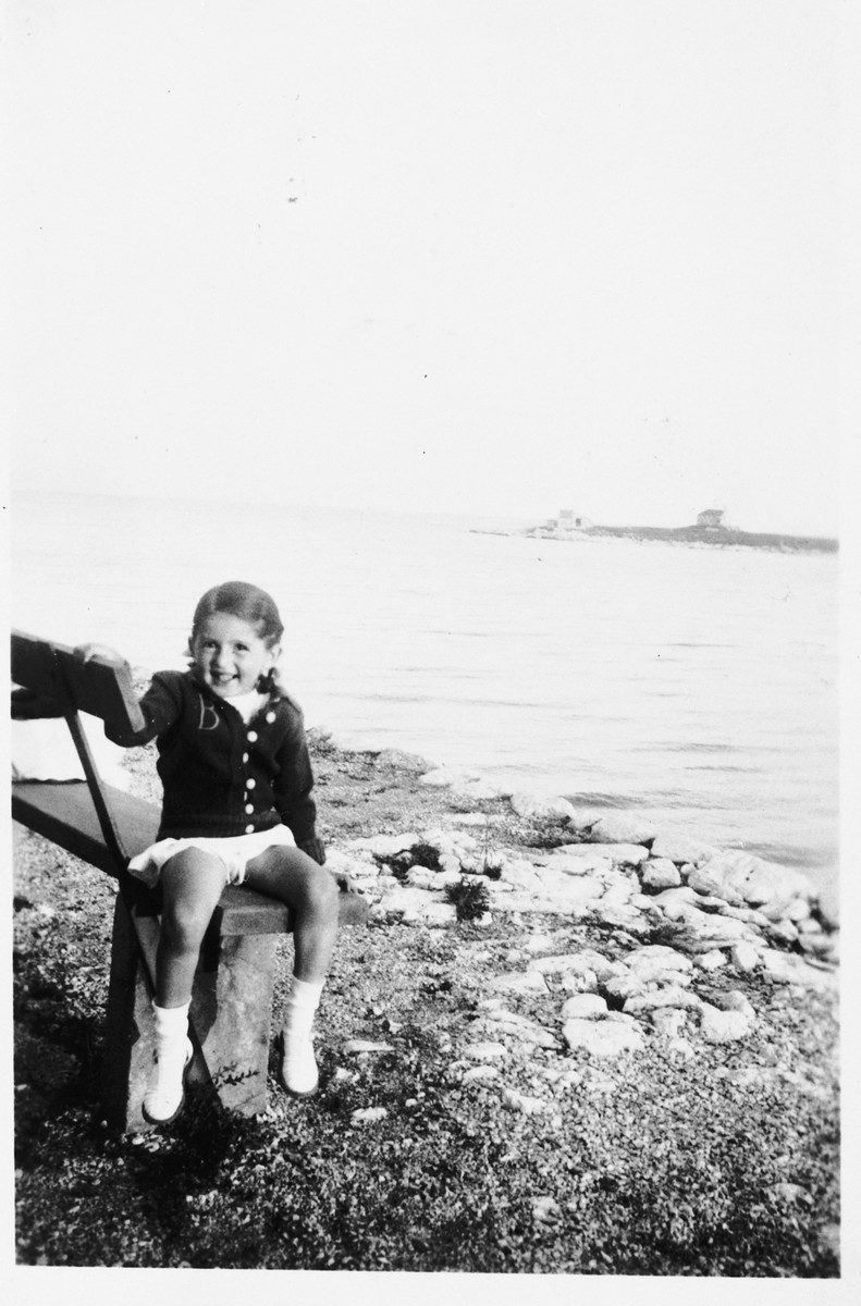 Branka Juhn sits on a bench by the seashore during a vacation to the Adriatic coast.