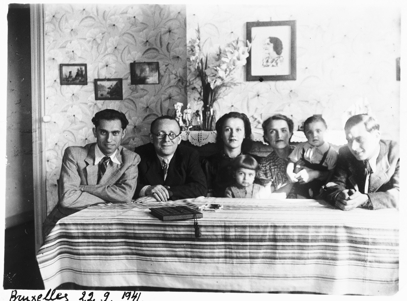 Members of the extended Ciechanow family are gathered in an apartment in Brussels.  Pictured from left to right are: Alex, unknown, Estera, Leah, Nathan and Adolf Ciechanow.  Adolf and Estera Ciechanow are the brother and sister-in-law of Alex Ciechanow.