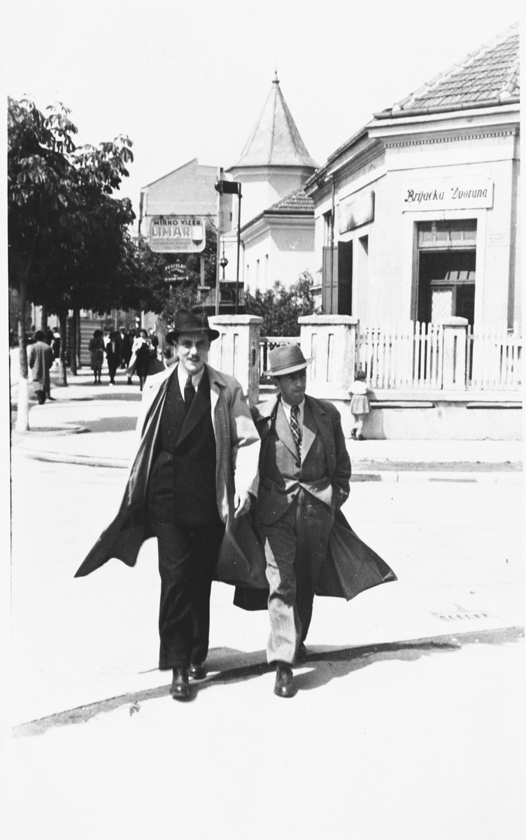 """Guido Juhn and a friend walk down a street of a provincial town in Croatia shortly before his arrest and deportation by the Ustasa militia.  The inscription on the back of the photograph reads, """"Greetings from Zdravko Horvat."""""""