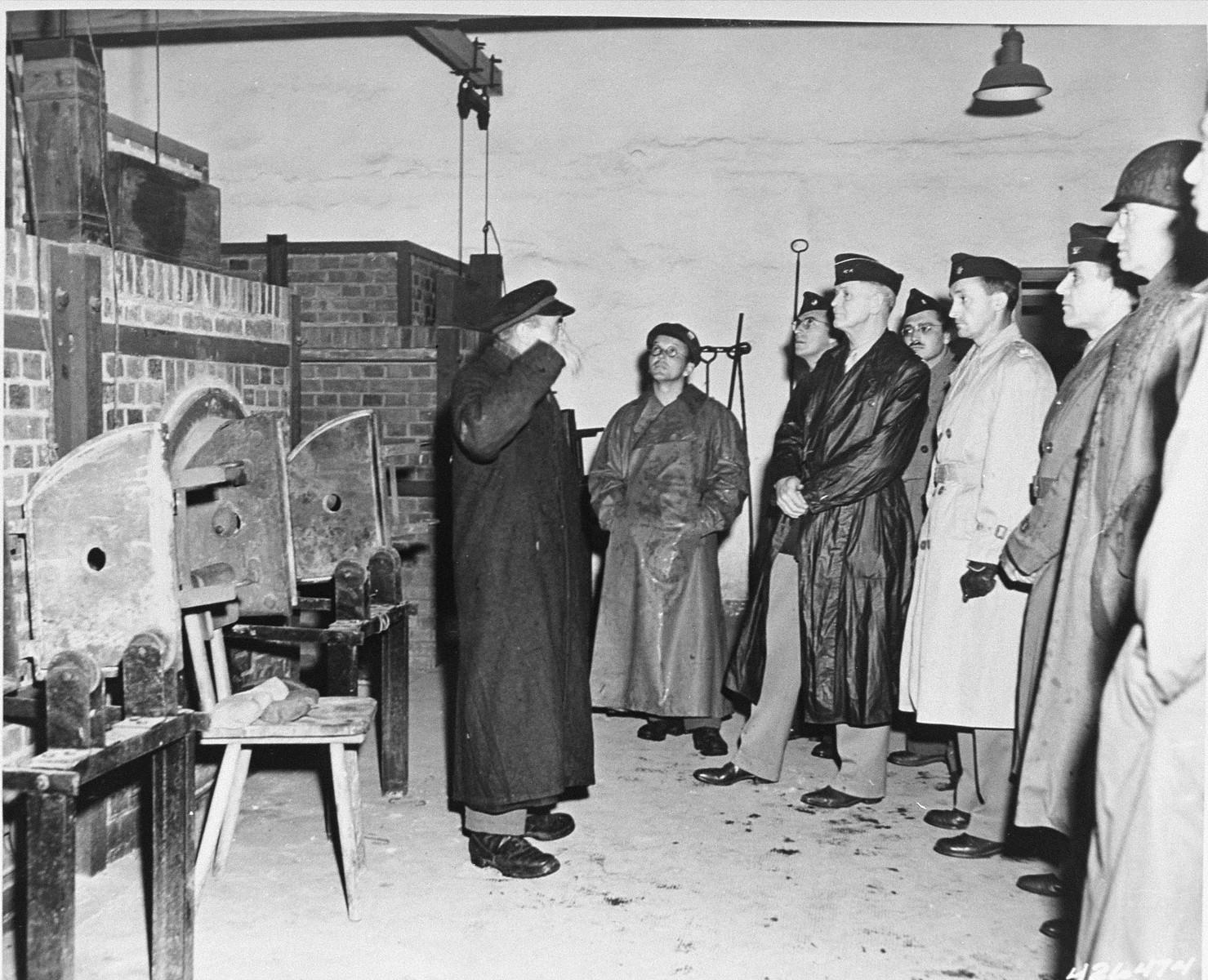 American congressmen view the open ovens in the Buchenwald crematorium.
