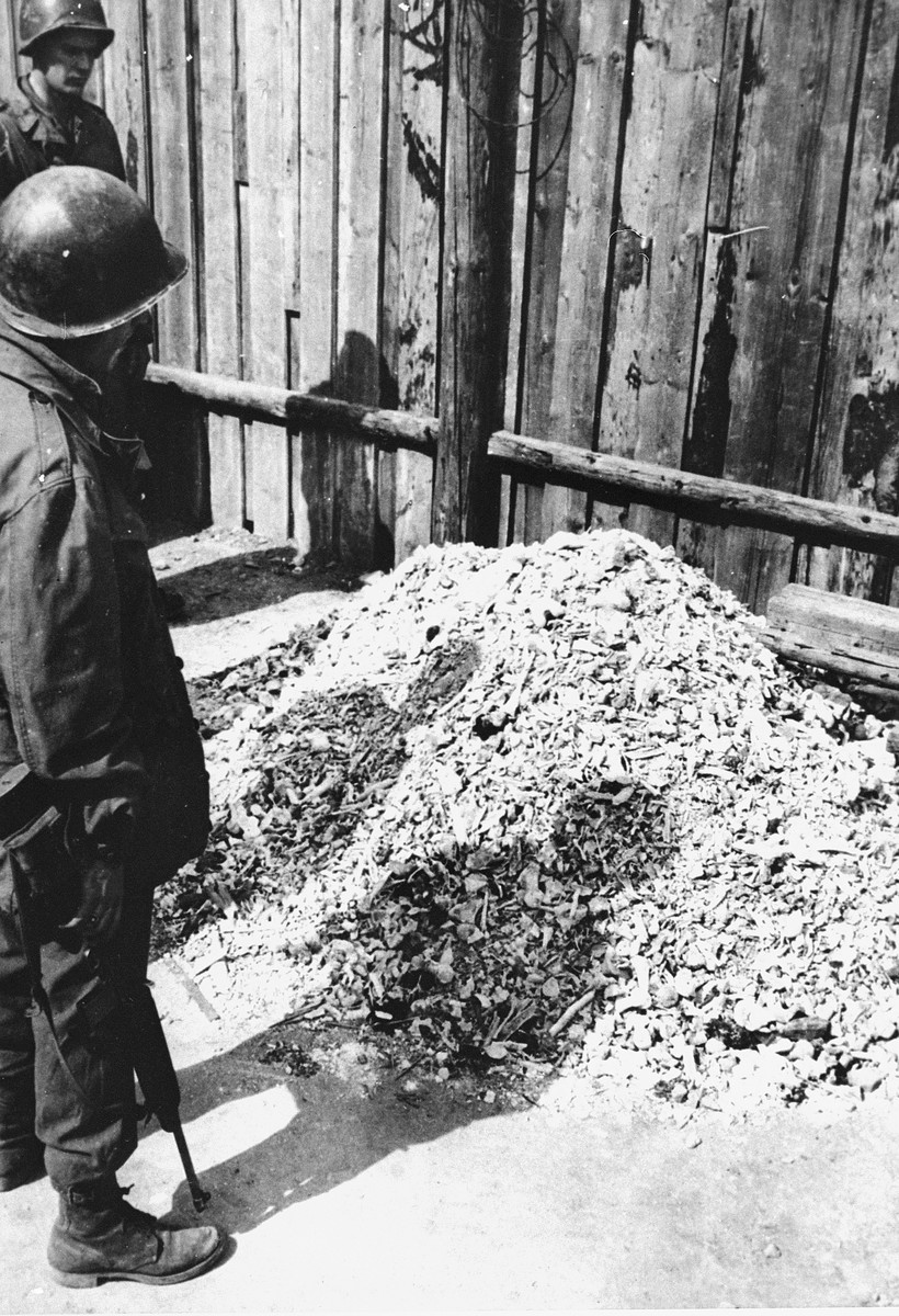 American soldiers view a pile of human remains outside the crematorium in Buchenwald.