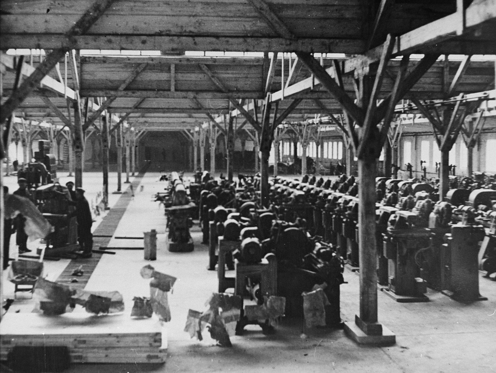 Prisoners at forced labor on the assembly line of the Gustloff Werke II munitions plant in the Buchenwald concentration camp.
