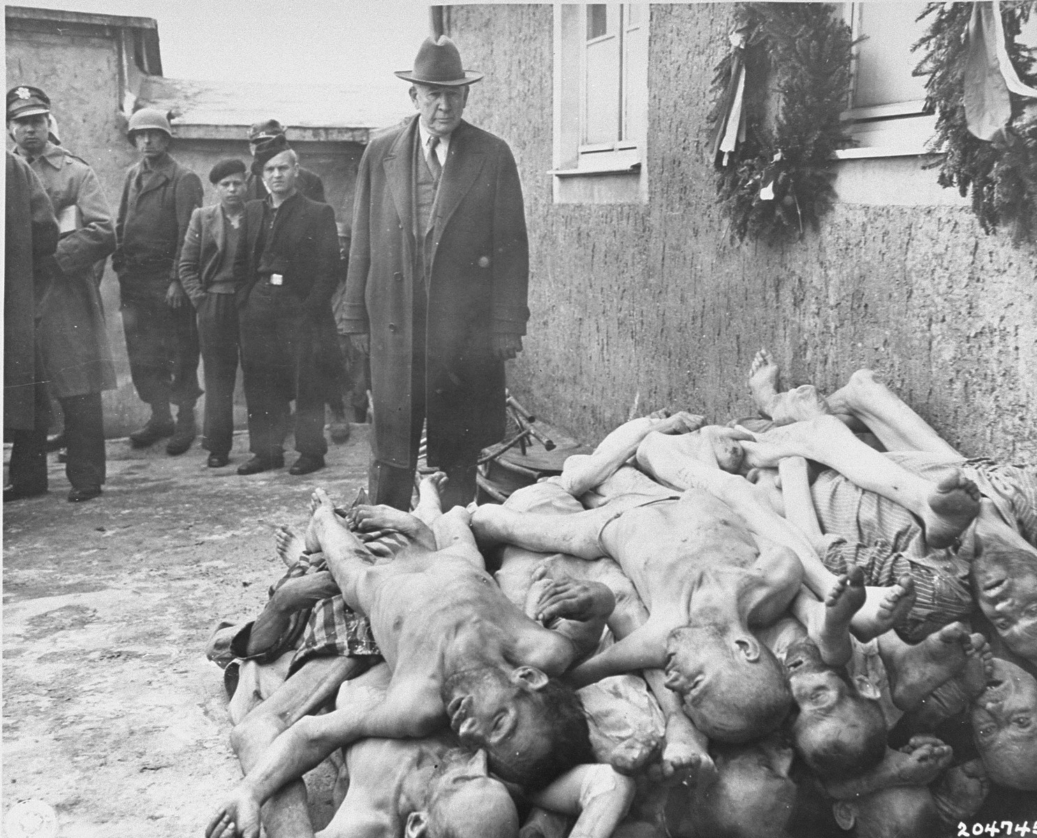U.S. Senator Alben W. Barkley of Kentucky, a member of a congressional committee investigating Nazi atrocities, views evidence in Buchenwald.