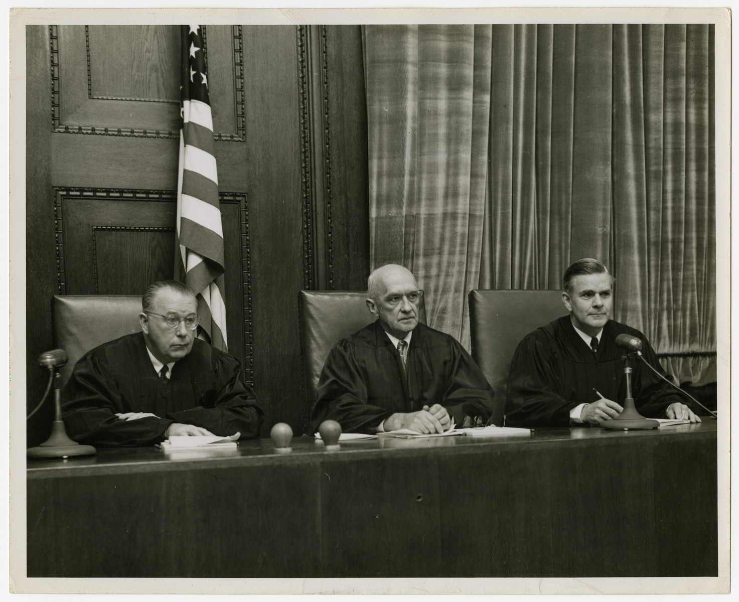 Close-up view of the judges bench during the Krupp Tribunal,.  From eft to right are Edward J Daly, Hu C Anderson and William J. Wilkins.