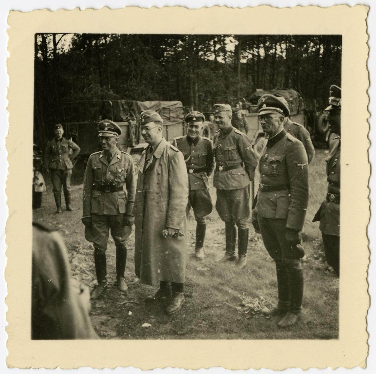 "Heinrich Himmler visits a German army encampment in France.  The original caption reads: ""Reichsfuehrerbesuch in Frankreich."""