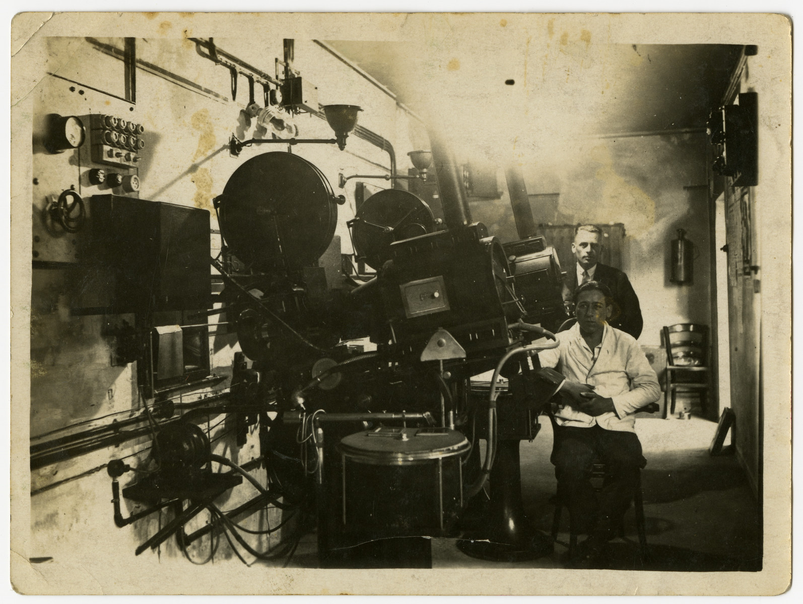 Projection studio of the Rheingold Theater, attatched to the Cohn's home.    The Nazis later confiscated the theater, and the young  German man pictured in the photograph assumed control.