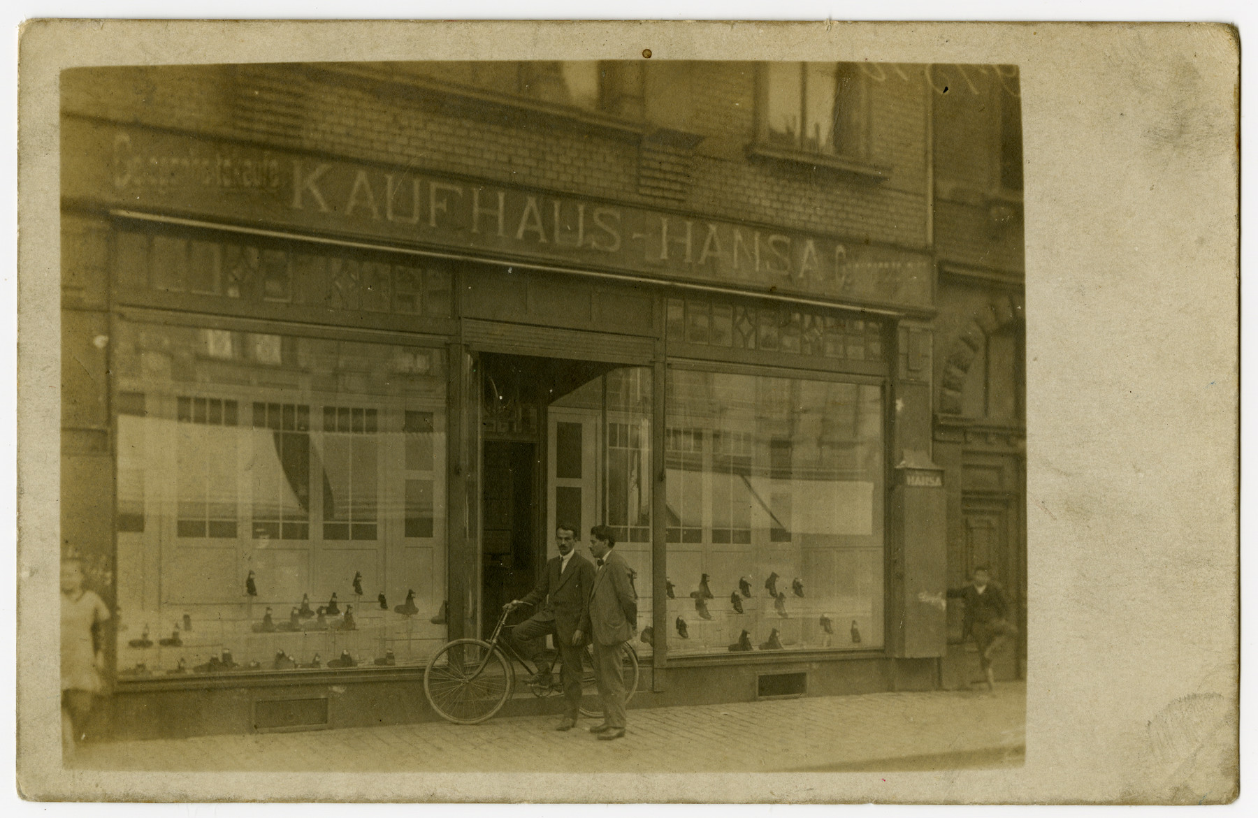 Marcus Cohn stands outside his father's shoe store in Ludwigshafen.