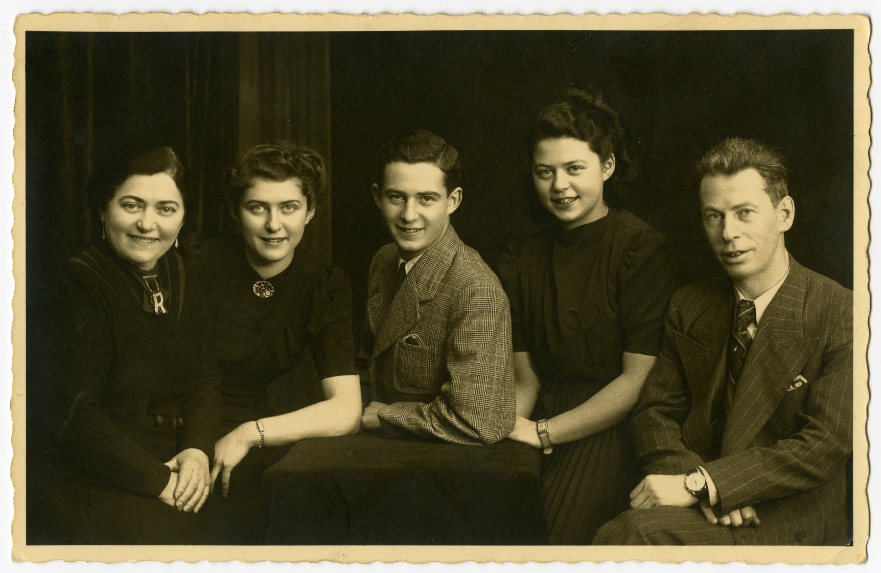 Studio portrait of the Landman family.  Pictured are Regina, Joan, Henry, Irma and Joseph.
