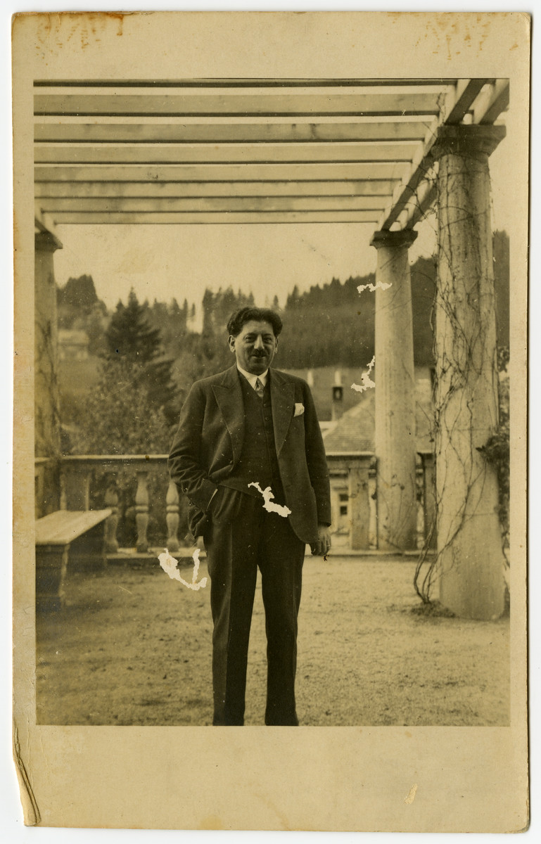 Marcus Cohn poses on the terrace of a sanatorium in Switzerland where he has gone for treatment for tuberculosis.