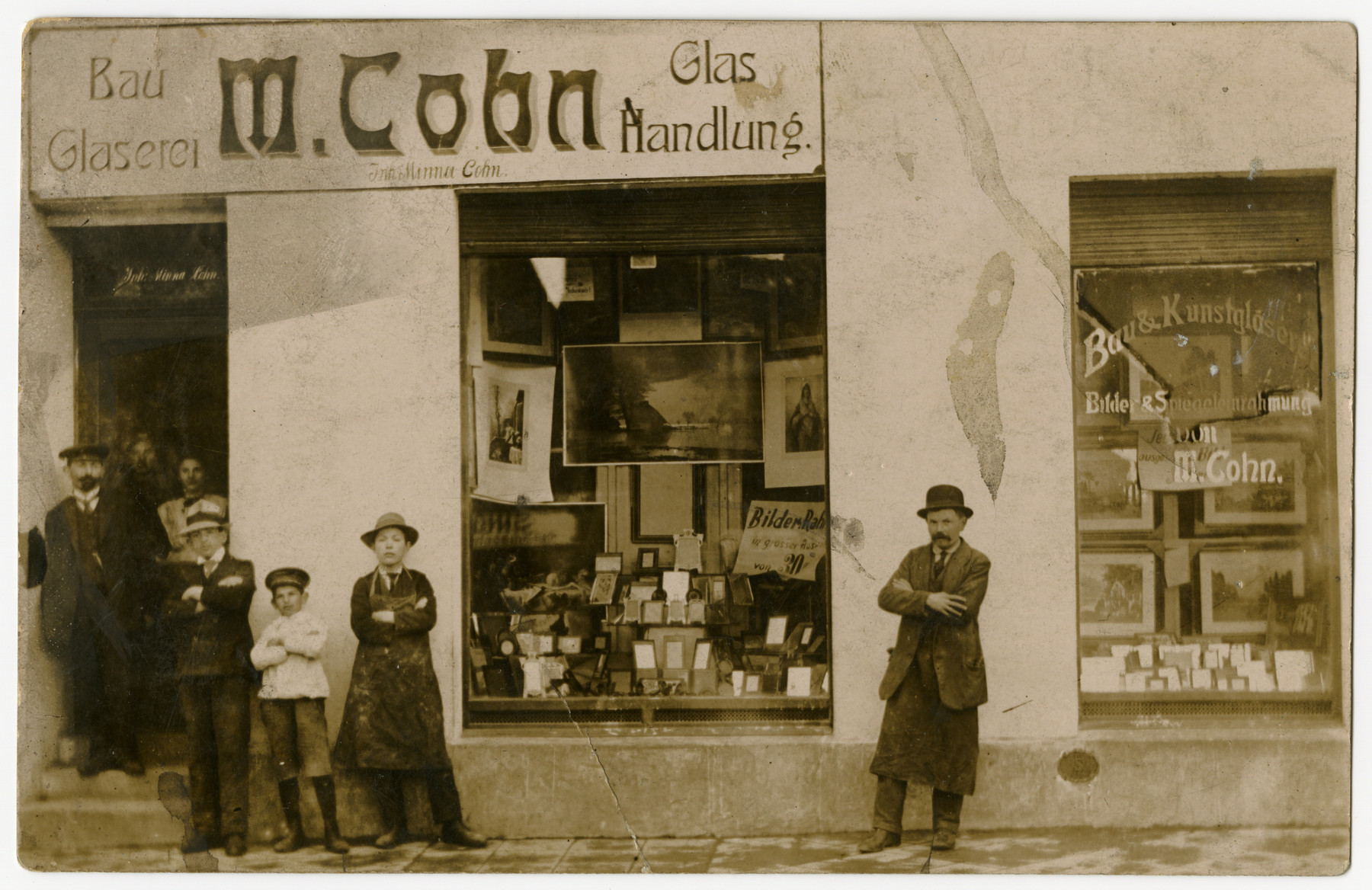 A group of men pose in front of the store belonging to Martin Cohn (grandfather of the donor).
