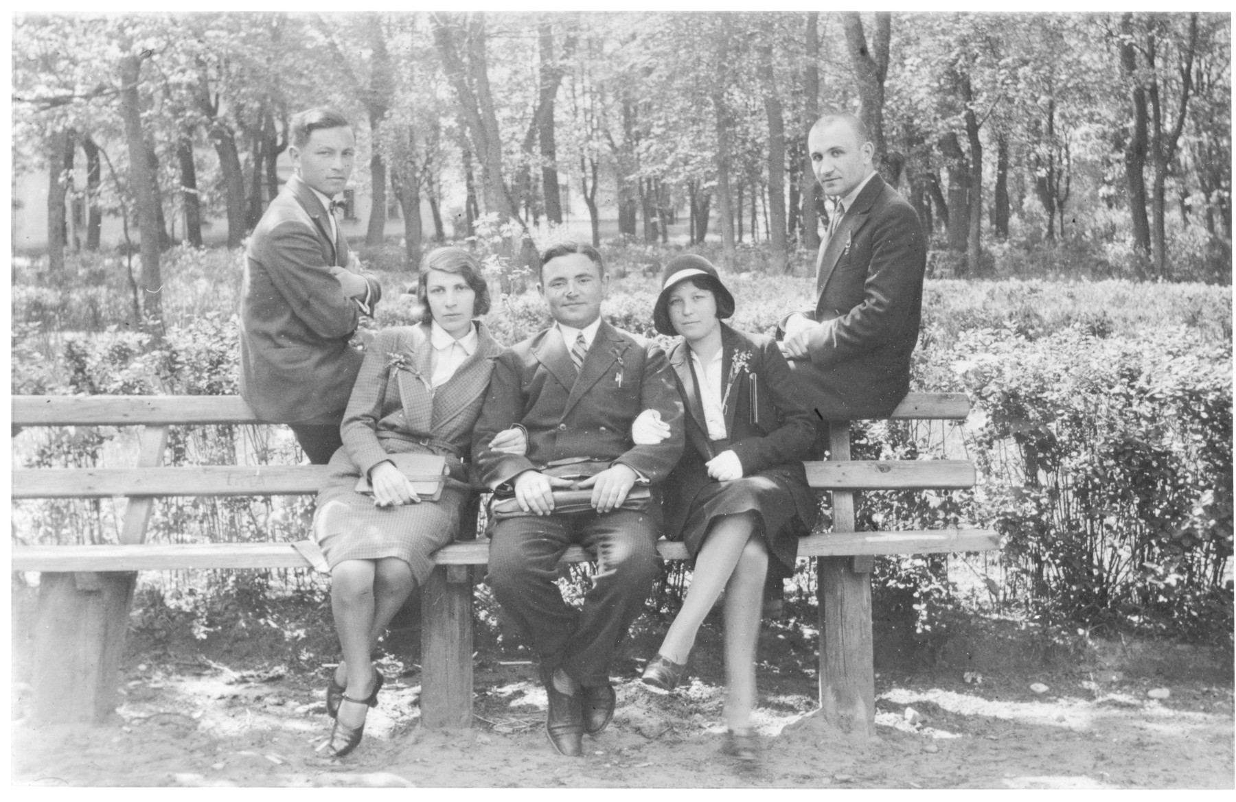 Jewish students pose on a bench at the University of Vilna.  Seated from left to right are: Rusia and her brother Abrasha Knyszynsky, Raya Markon and Max Heller (behind on the right).
