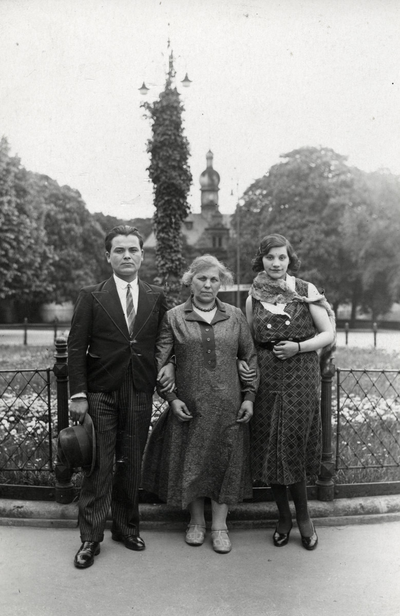 A Jewish family poses outside a park in Luxembourg.  Pictured are Aron Joseph Salomon, Rachel Leah Wonagus, and Ida Wonagus Salomon.