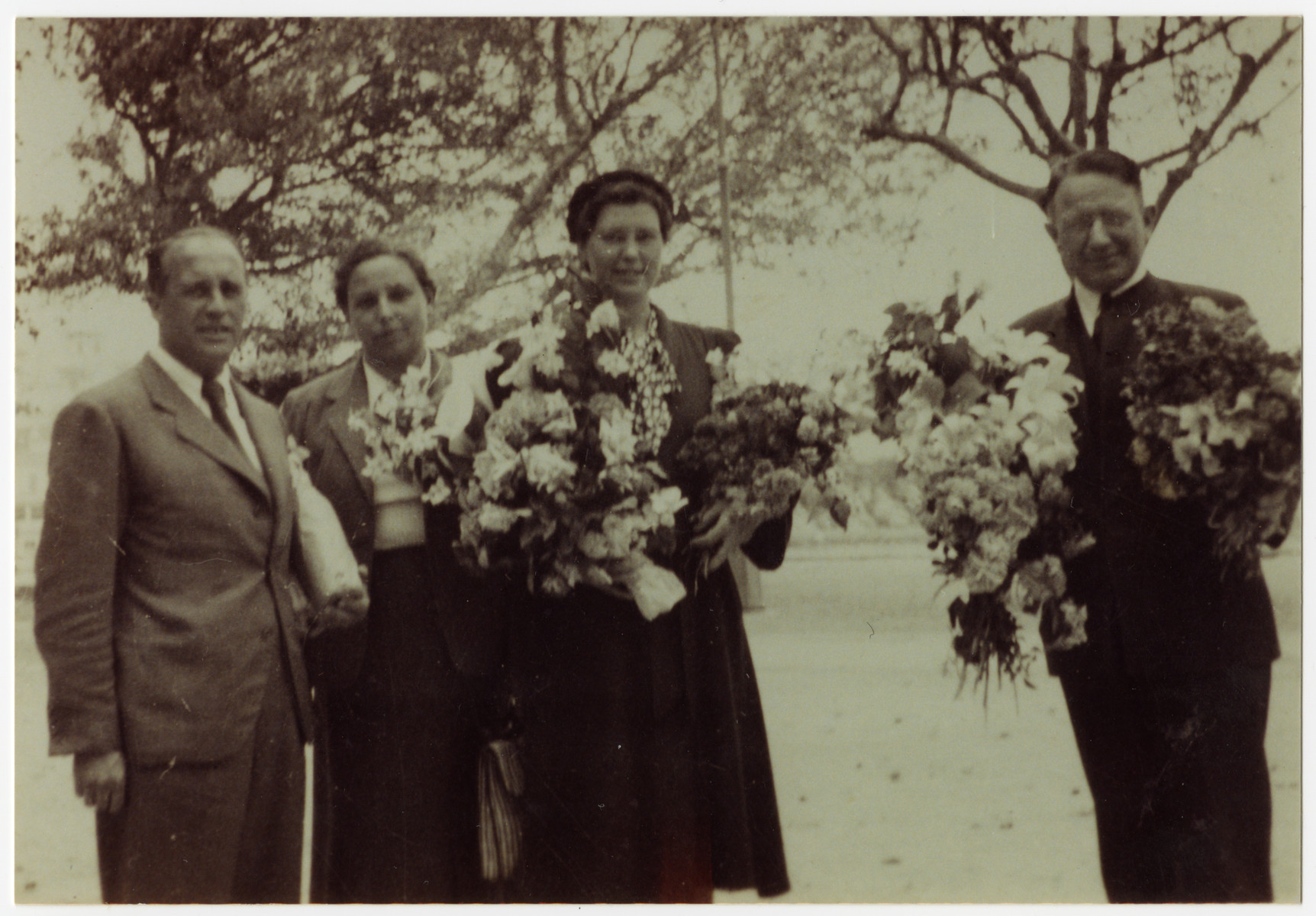 Group portrait of the staff of the Villa Saint Christophe in Canet-Plage.  Lois Gunden is pictured third from the left.  Augustin Coma is on the far left.  Next to him is Mme. Pepita and Joseph Byler is on the right.