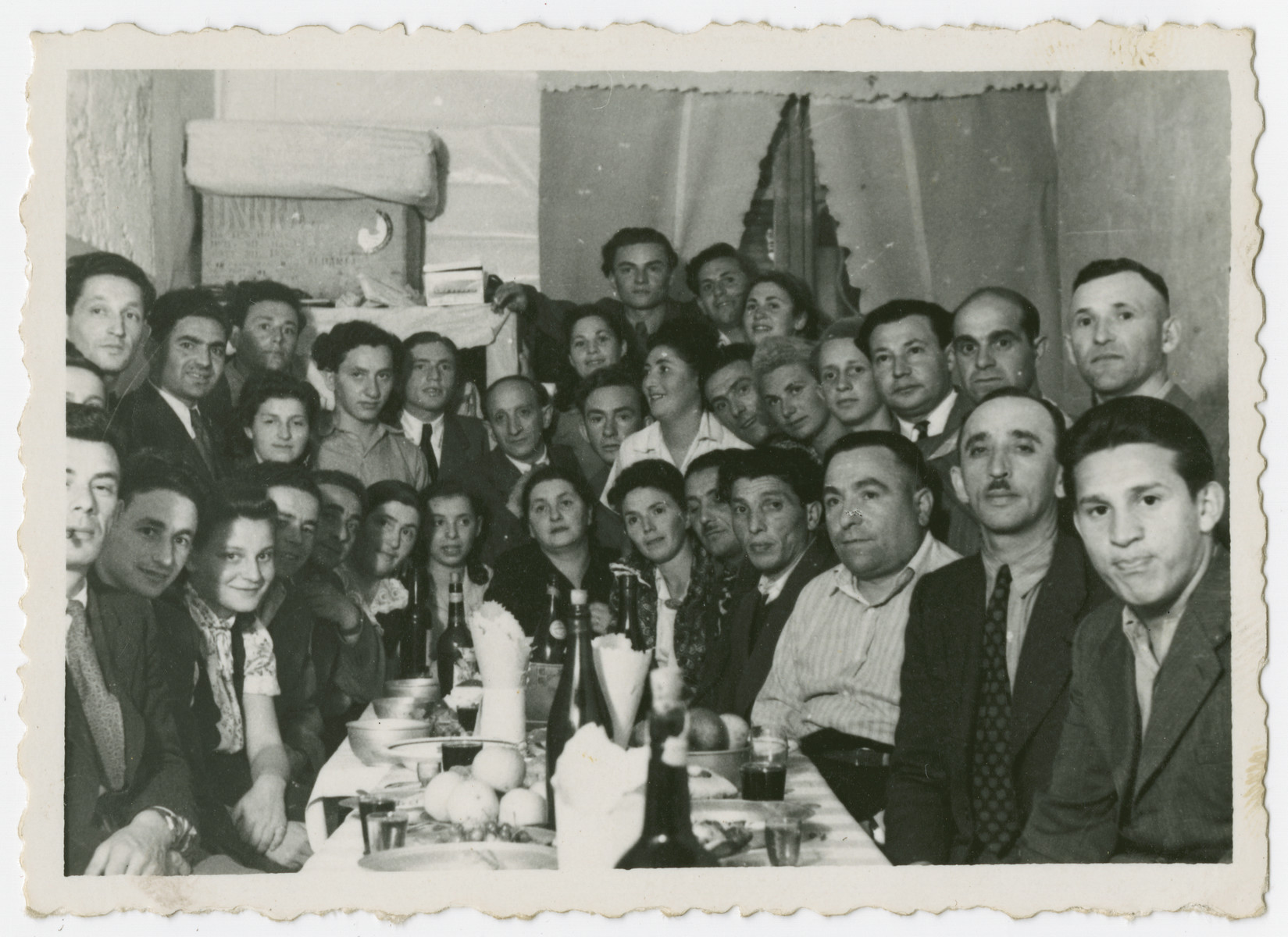 Jewish DPs attend a going-away party in the Bari camp.