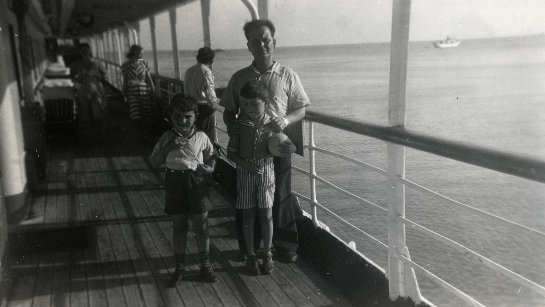 Aaron Joseph Salomon poses on the deck of the Algonquin with his sons Marcel and Alex while en route to the Dominican Republic.