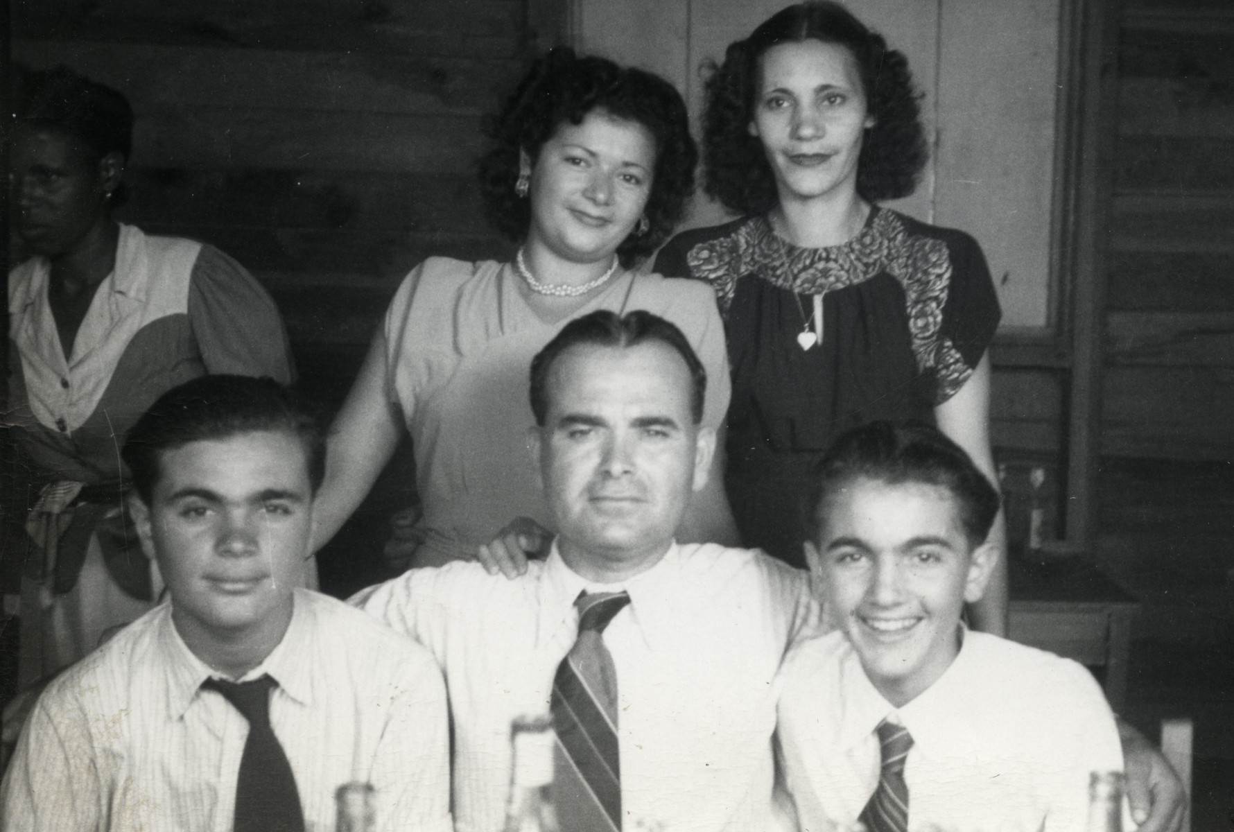 Portrait of the Salomon family in the Sosua refugee colony.  Seated left to right are Alex, Aron Joseph and Marcel Salomon.  Ida Salomon is standing on the right.