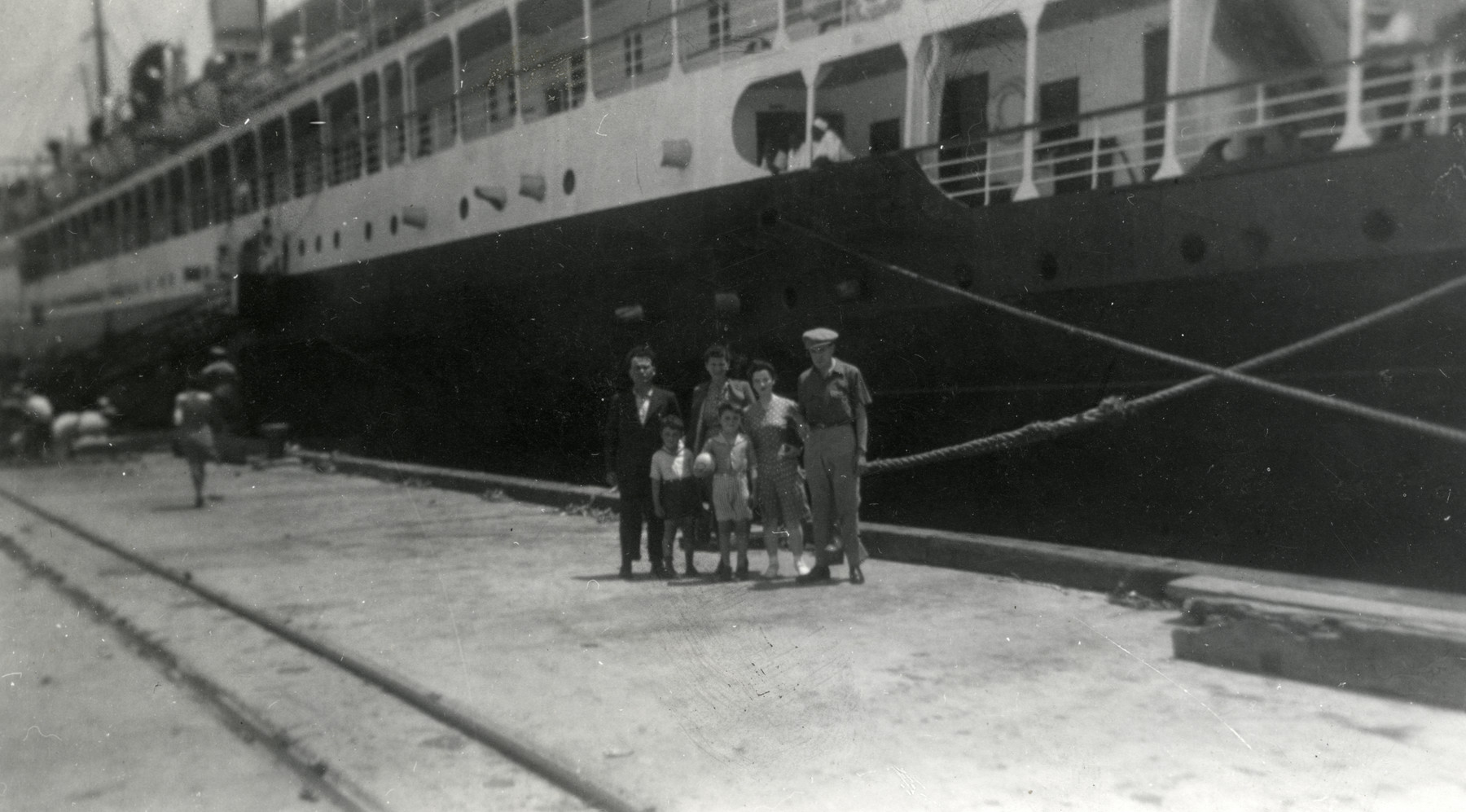The Salomon family poses on the dock in New York prior to boarding the Algonquin which will take them to the Dominican Republic.