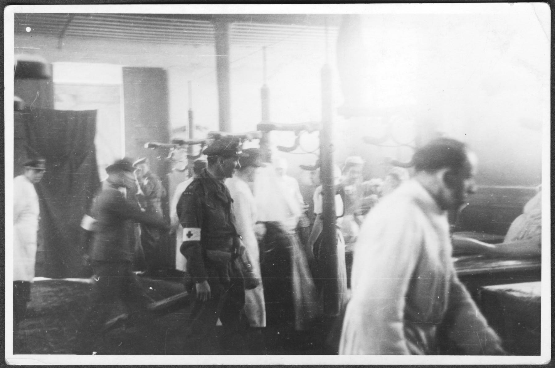 British medical personnel at work in the barracks established for washing and disinfecting survivors in Bergen-Belsen.