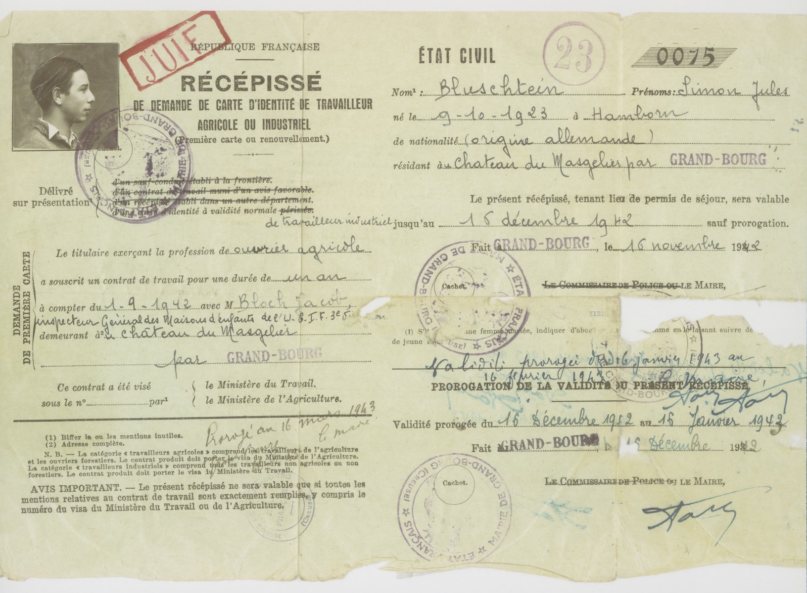 "A work permit stamped with the word ""Juif"" [Jew], that was issued to Julien Bluschtein in December 1942."