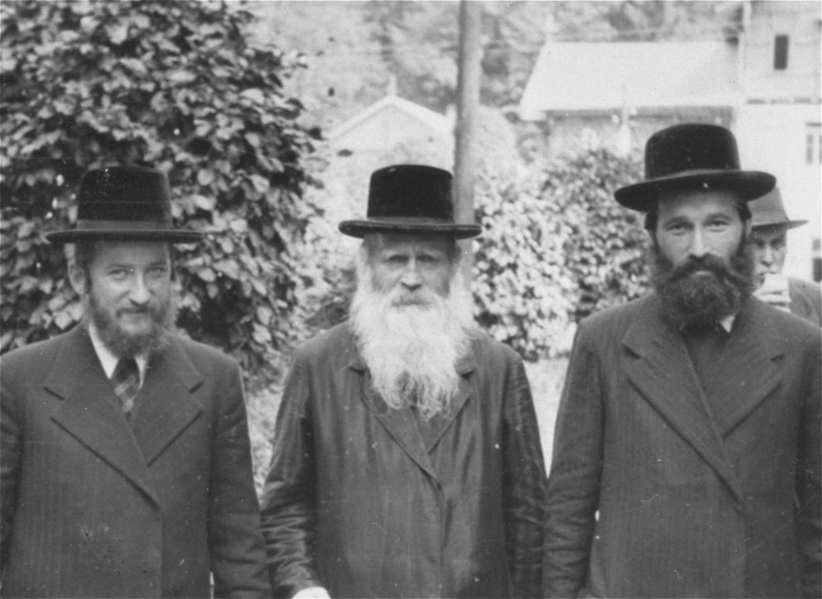 Three religious Jews pose on a street at a resort in the Tatra Mountains.    Pictured from left to right are:  Shaye David Lische, Isak Saleschütz and Reuven Weinstein.