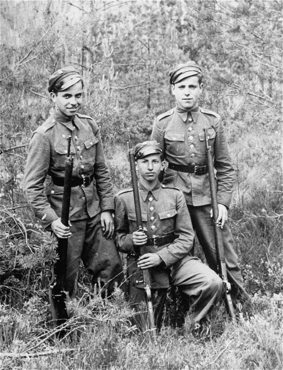 Joshua Heilman, (left) with his brother Zev (right) and a friend, Zygus Weissberg, during high school military training.
