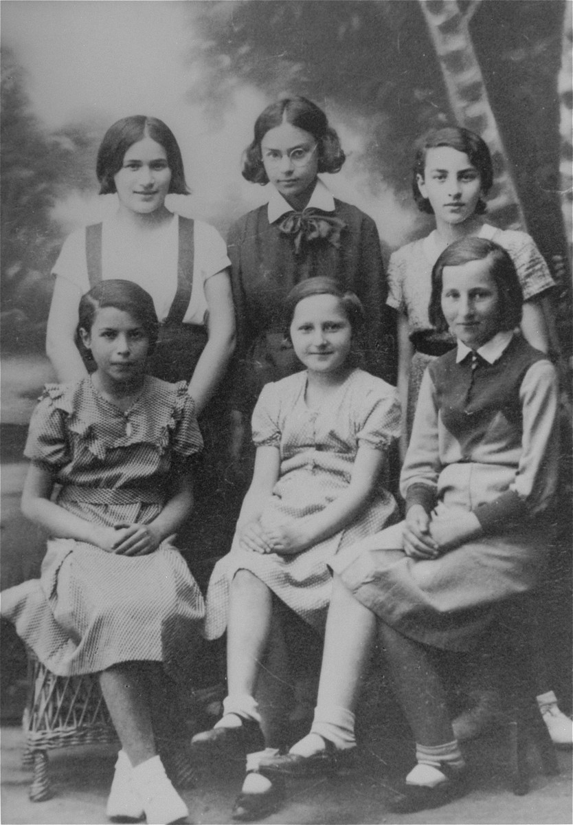 Group portrait of six girls in the Hashomer Hatzair Zionist youth movement in Ciechanow.  Pictured seated from left to right are: unknown, Pschulka, Kostrzeva.  Standing from left to right are: Roza Robota, Ruth Kirshenzweig and Lola Kirsh.
