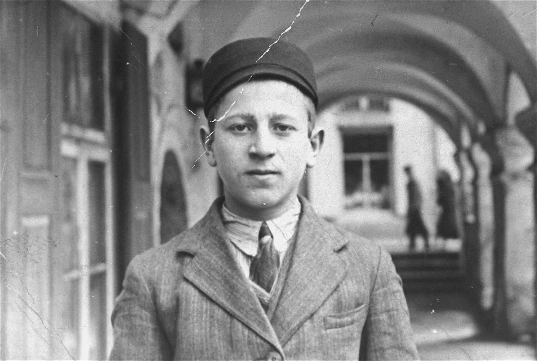 Portrait of a student in the courtyard of a yeshiva in Zamosc.  Pictured is Lajzer Frajd.