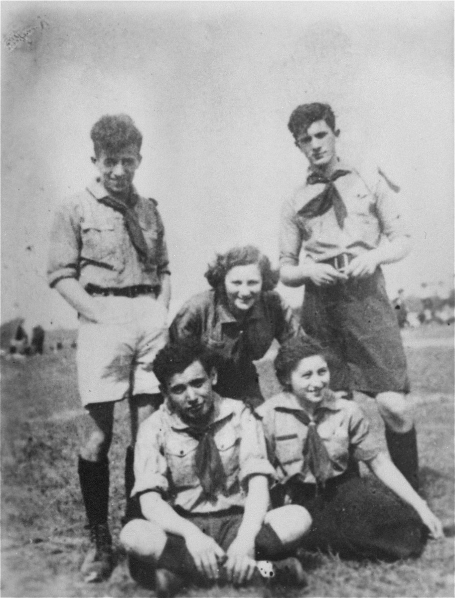 "Group portrait of members of the Hashomer Hatzair socialist Zionist youth movement.    Pictured in the back row, left to right, are: Tzvi Braun, Shifra Sokolka and Mordechai Anielewicz.  Seated in front are Moshe Domb and Rachel Zilberberg (""Sarenka"")."