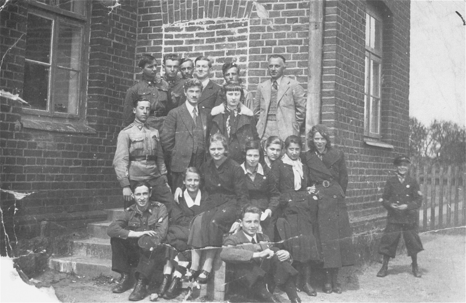 Group portrait of students and teachers in a public Polish high school in Wegrow, where many of the students were Jewish.    Wladyslaw Wojcik is pictured standing in the second row, first on the left.