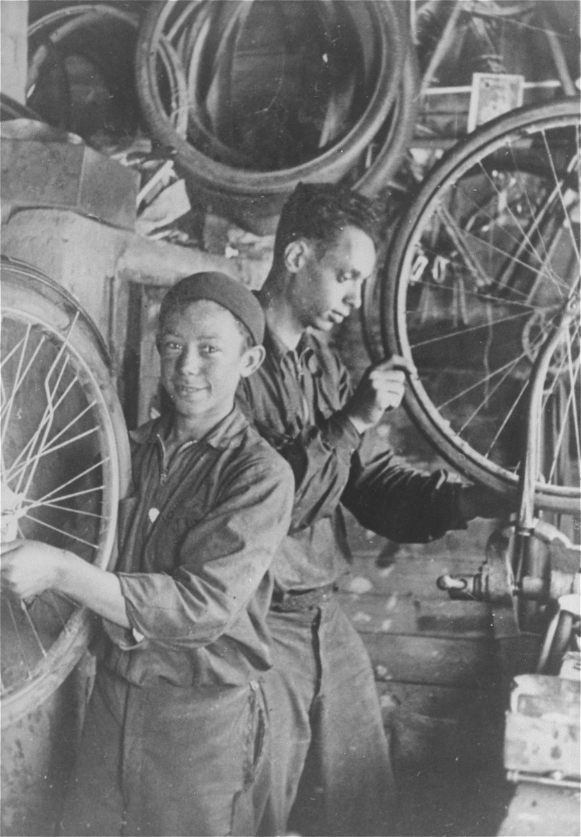 Leonard Bobrowski and his cousin Jankiel Bobrowski work in a bicycle workshop.   Jankiel was murdered in Brest in 1941.