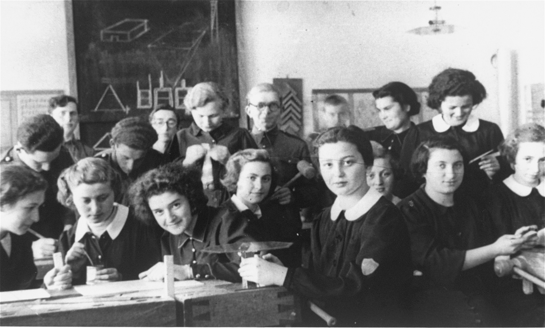 Students attend an industrial arts class at the Jewish gymnasium in Stanislawow.  Among those pictured are Amalie Petranker (first row, fourth from the left) and Pepka Petranker (standing behind Amalie).