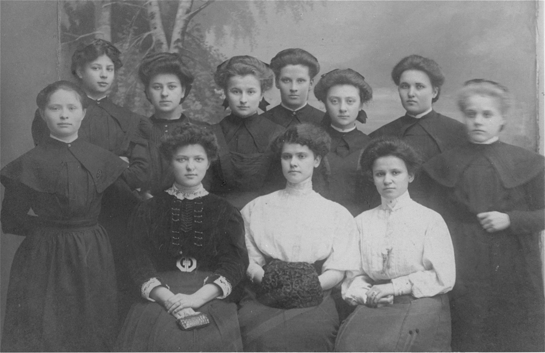 Group portrait of young women in the gymnasium for Deaf students.  The donor's mother, Rebeka Jaglom Wajcblum, is standing in the back row, third from the left.