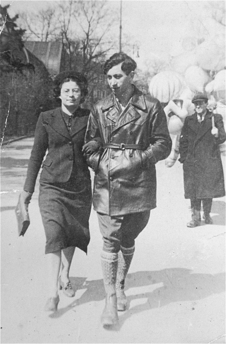 Josef Kaplan and Halina Semadar walking in the streets of Warsaw.  Josef Kaplan (1913-1942), was a leader of the Hashomer Hatzair socialist Zionist youth movement in interwar Poland.  During the Nazi occupation he took charge of the movement's underground organization and coordinated its activities in the various ghettos.  In the summer of 1942 Kaplan helped found the ZOB [Jewish Fighting Organization] in Warsaw.  Two months later, however, on September 3, 1942, he was captured and killed by the Germans while preparing forged documents for members of the underground, who were about to escape to the forests to join the partisans.