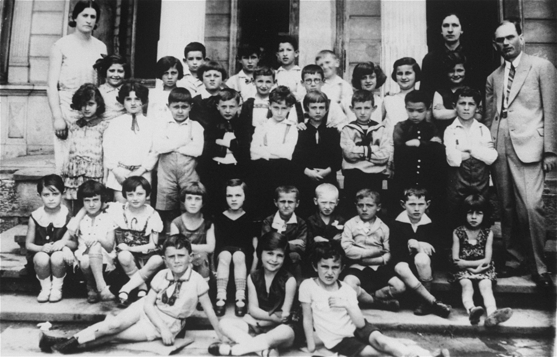 Class portrait of children at a Jewish primary school in Stanislawow.  Amalie Petranker is pictured in the third row from the front, fourth from the right.