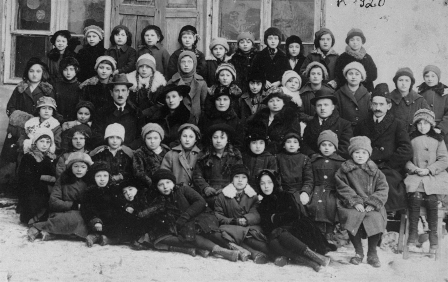 Class portrait at a public elementary school in Vilna.  Raya Magid is pictured in the front row, second from the left.