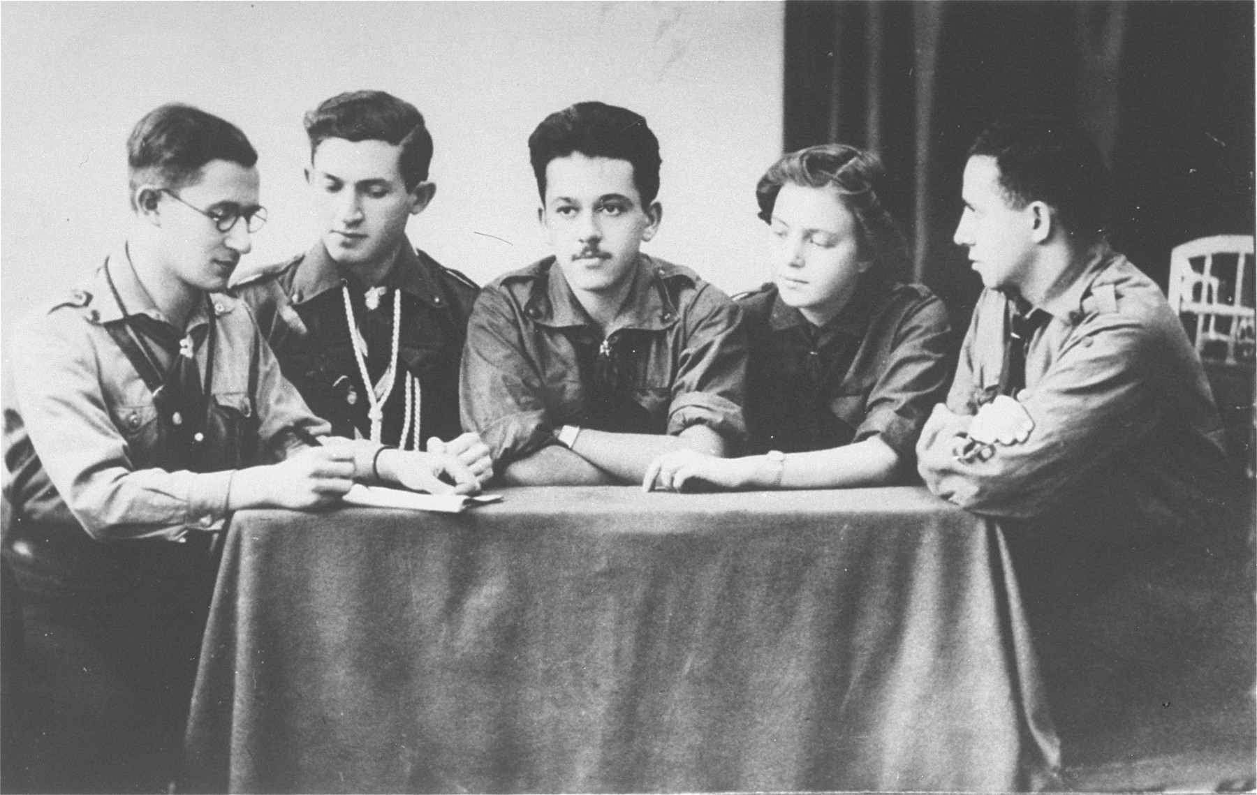 Group portrait of members of the Hanoar Hatzioni Zionist youth movement in Sosnowiec.  All were active in the Zionist underground in Sosnowiec during the German occupation.  Pictured from left to right are, Dr. Bursztyn, Josef Kozhuch, Samek Meitlis, Lola Pomeranzblum, and Benjamin Bimko (the donor's brother).  Samek and Lola were married.  All but Dr. Bursztyn were shot by the Germans during the final liquidation of the ghetto in August 1943.