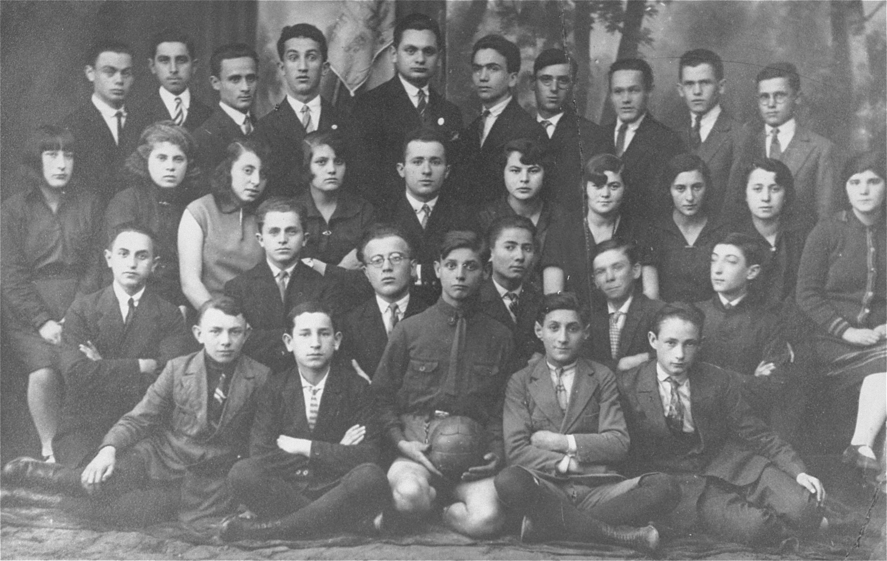 Group portrait of members of the Maccabi Jewish sports club in Kozienice.  Among those pictured are: Edzia Kestenberg (third row, second from theleft), Karpman (second row, second from the left), Ester Diamand (third row, sixth from the left) and Malka Raizel Lichtenstein (third row, fourth from the right).