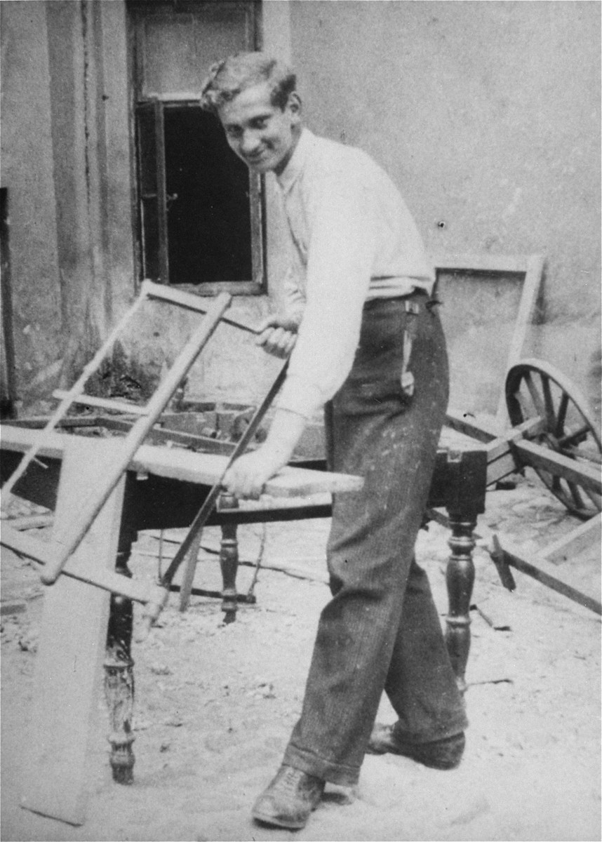 A Jewish youth does carpentry work at a hachshara [Zionist collective] operated by the Hashomer Hatzair Zionist youth movement in Piotrkow Trybunalski.  Pictured is Mordechai Baron.