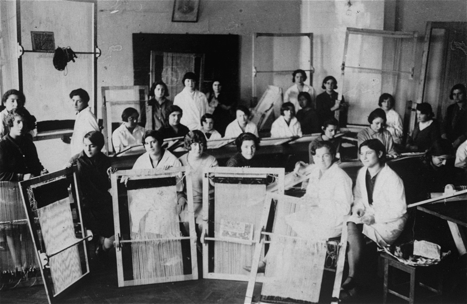 Jewish youth attend an afterschool weaving class in Vilna.   Among those pictured is Rosa Rudashevsky (front row, second from left).