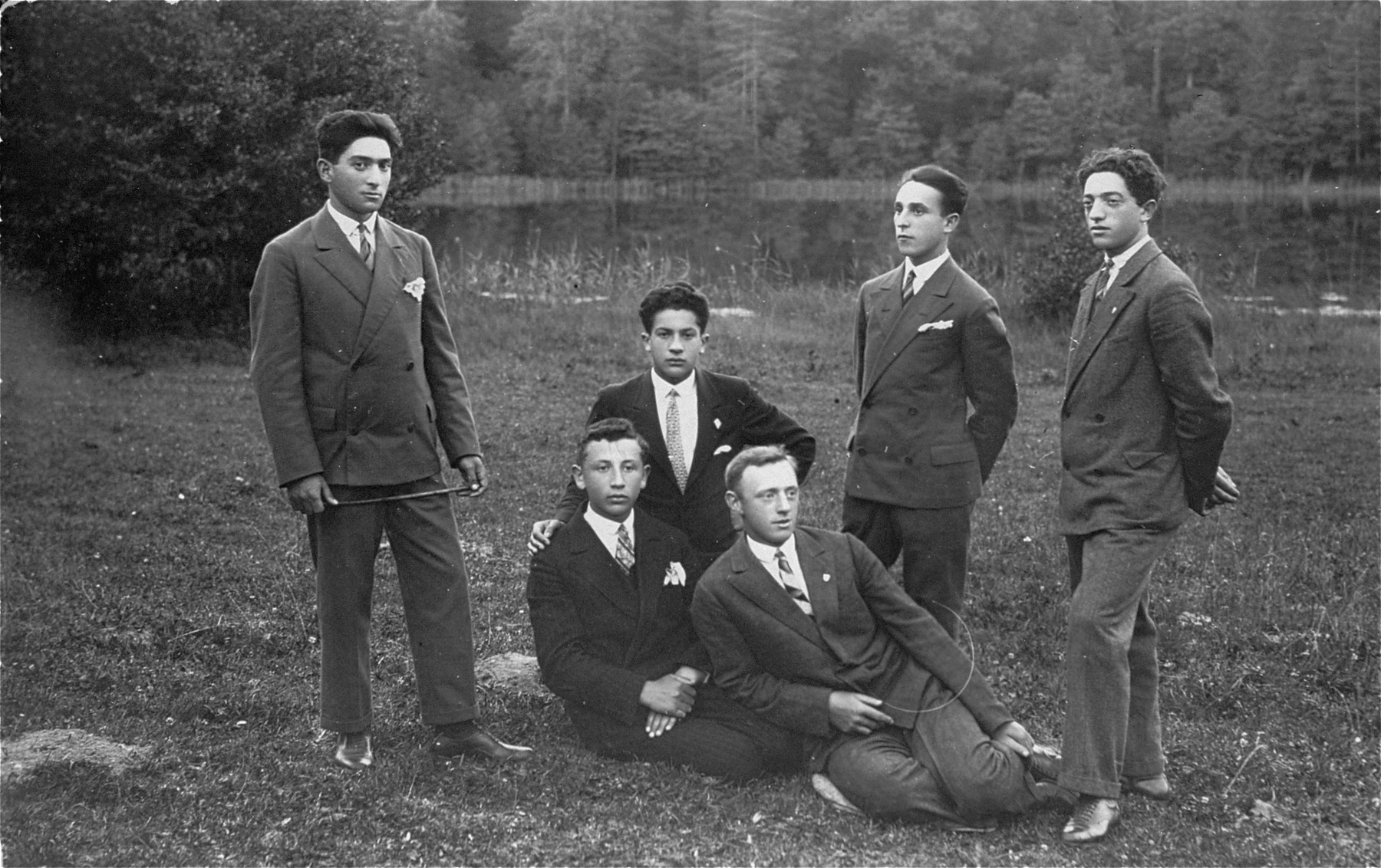 A group of young Jewish men pose in a park in Lithuania. Pictured at the right is the donor's father, Eliezer Kaplan.