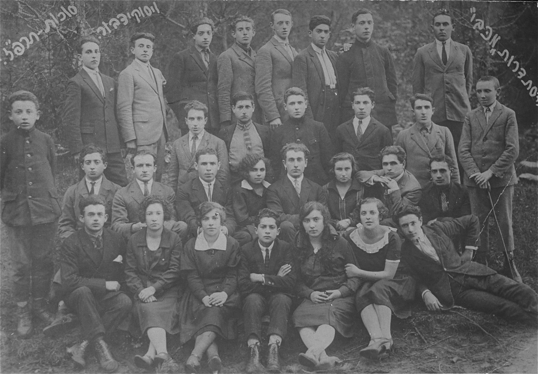 Group portrait of members of the Maccabi sports organization in Visokidbor, Lithuania, taken on the Jewish holiday of Sukkot.