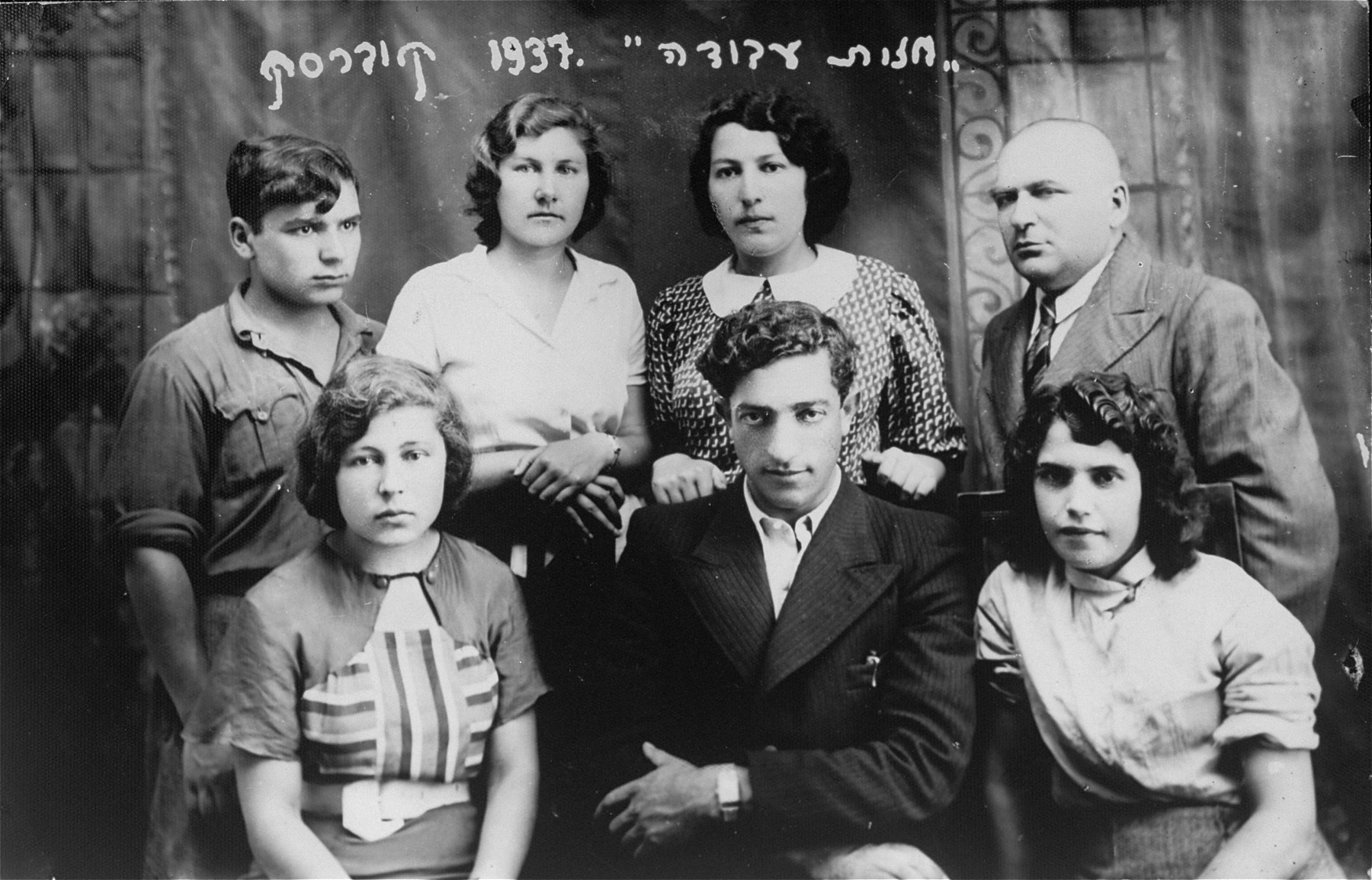Group portrait of members of the Zionist Labor Front in Kovarskas, Lithuania.  Pictured in the front row is Eliezer Kaplan.