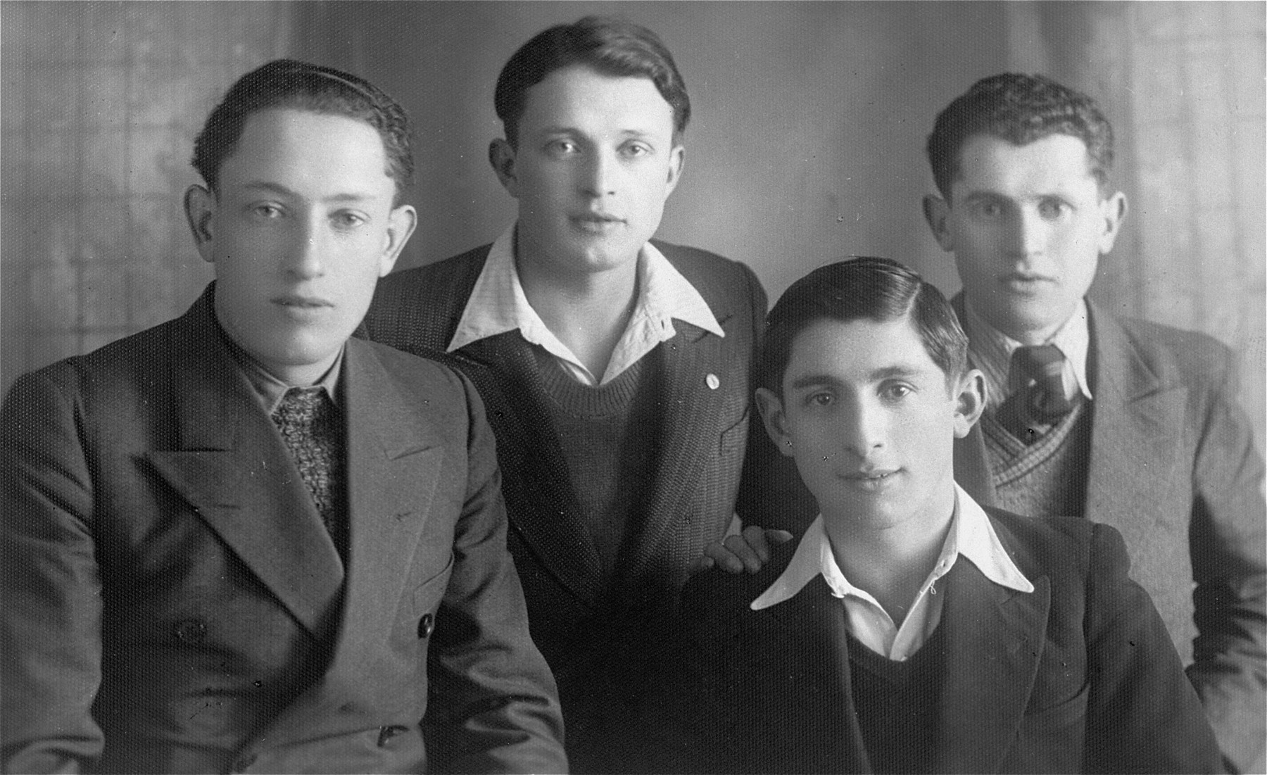 Group portrait of four young Jewish men who were friends of the donor's father, Eliezer Kaplan, from the Zionist movement in Lithuania.