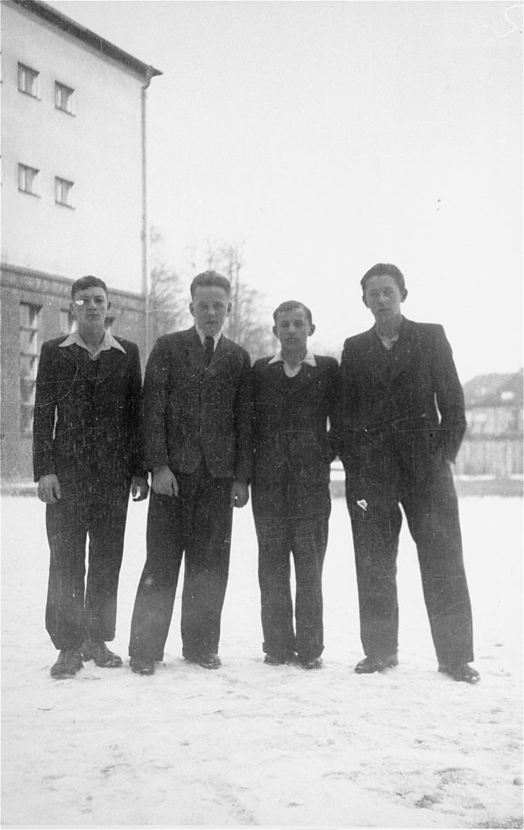 Hirsch Birman poses with three Lithuanian classmates.