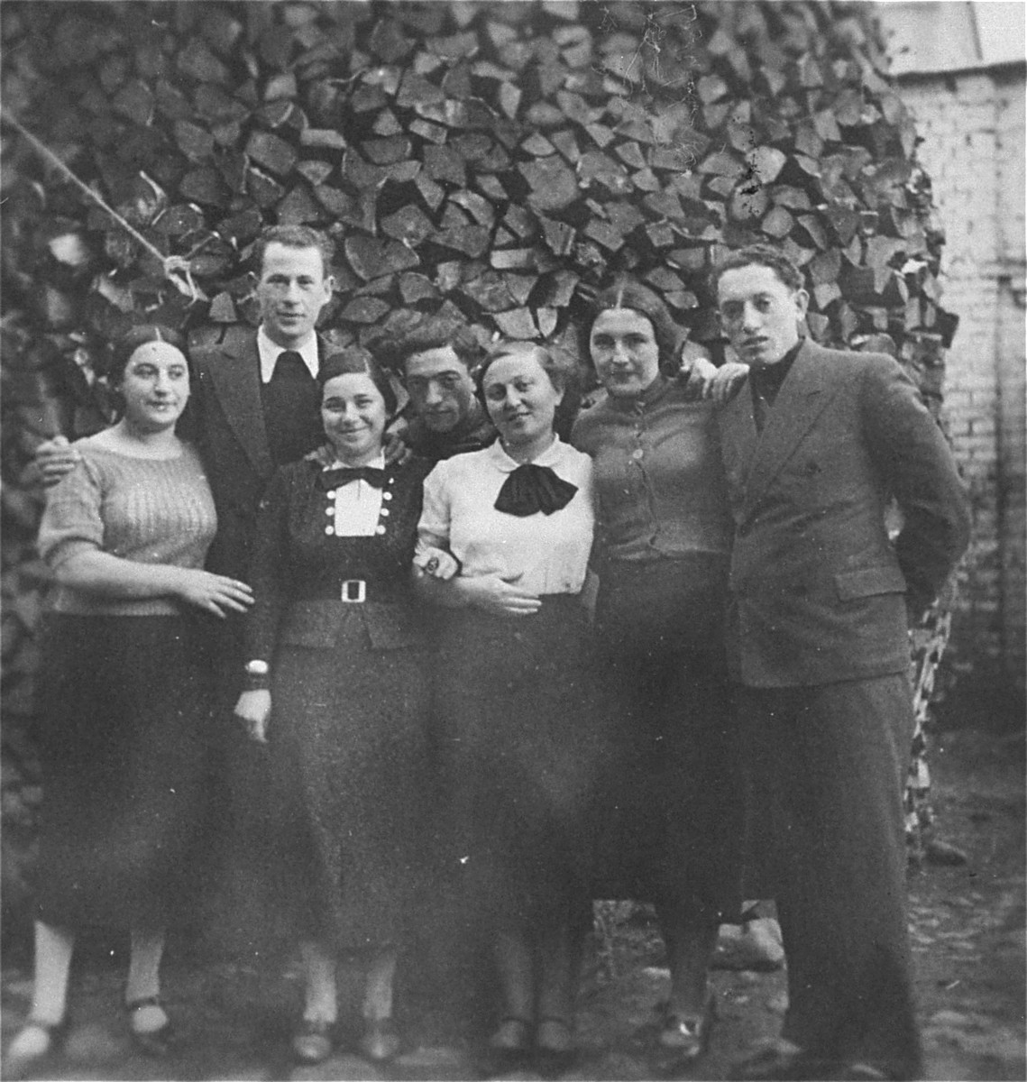Eliezer Kaplan (right) poses with a group of friends in Lithuania.